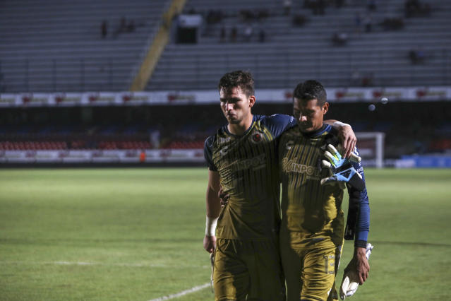 Veracruz players stood still in protest over unpaid wages as they got scored on. (AP Photo/Felix Marquez)