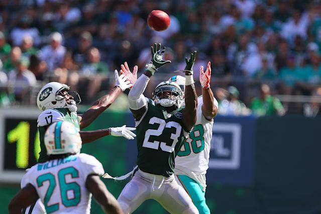 <p>New York Jets defensive back Terrence Brooks (23) intercepts a pass on a fake punt during the National Football League game between the New York Jets and the Miami Dolphins on September 24, 2017, at MetLife Stadium in East Rutherford, NJ. (Photo by Rich Graessle/Icon Sportswire via Getty Images) </p>