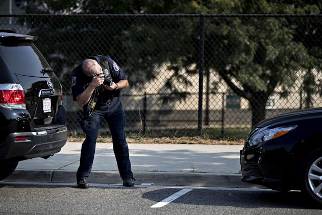 <p>A crime scene investigator takes a photograph near the Eugene Simpson Stadium Park in Alexandria, Virginia, U.S., on Wednesday, June 14, 2017. (Photo: Andrew Harrer/Bloomberg via Getty Images) </p>