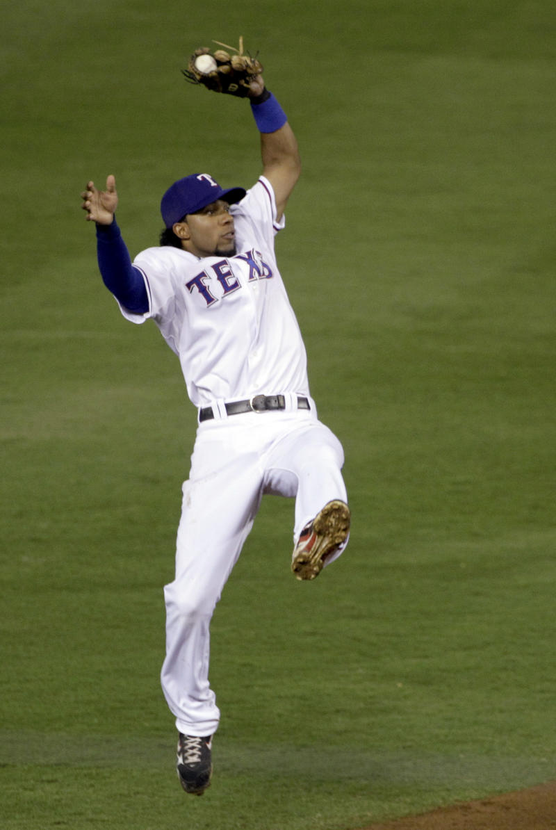 Texas Rangers shortstop Elvis Andrus makes a leaping catch to rob New York Yankees' Alex Rodriguez of a hit in the second inning of Game 6 of baseball's American League Championship Series Friday, Oct. 22, 2010, in Arlington, Texas. (AP Photo/Paul Sancya)