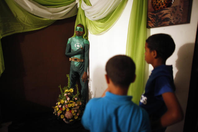The body of Renato Garcia was dressed as the superhero the Green Lantern for his 2015 wake in San Juan, Puerto Rico. (Photo: AP Photo/Ricardo Arduengo)