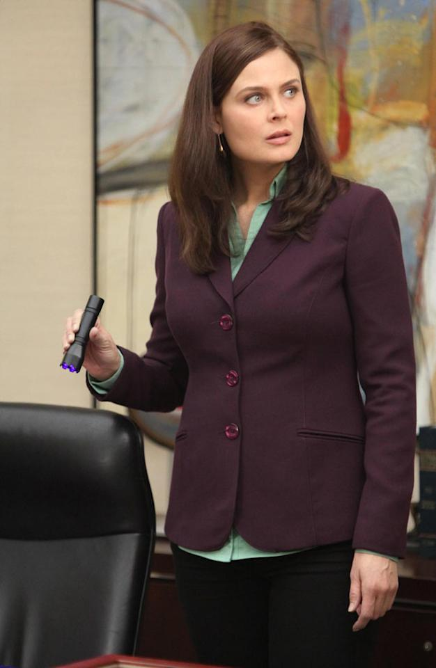 "Brennan (Emily Deschanel) searches for blood at the office of a recently murdered high-powered divorce lawyer in ""The Partners in the Divorce"" episode of ""Bones."""