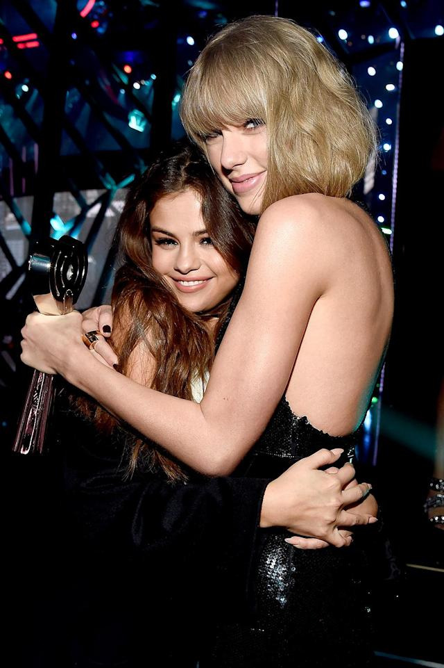 "<p><strong>Status</strong>: In<br><strong>Why</strong>: Selena Gomez is one of the founding members of Taylor's squad and she's not going anywhere. The ""Bad Liar"" singer — who even subtly gave Swift <a href=""https://www.yahoo.com/celebrity/selena-gomez-fans-taylor-swift-153500638.html"" data-ylk=""slk:a shoutout in her new music video"" class=""link rapid-noclick-resp"">a shoutout in her new music video</a> — was recently pressed about <a href=""https://www.yahoo.com/celebrity/taylor-swift-learned-past-kept-romance-joe-alwyn-insanely-private-135007847.html"" data-ylk=""slk:her BFF's new boyfriend"" class=""link rapid-noclick-resp"">her BFF's new boyfriend</a>, Joe Alwyn. ""Honestly, if my friends are happy, that makes me happy. That's all I care about,"" she said. Unlike Lorde, Selena knows how to handle coyly <a href=""https://www.yahoo.com/celebrity/selena-gomez-talks-relationship-weeknd-says-havent-feeling-191813066.html"" data-ylk=""slk:talking about Taylor in interviews"" class=""link rapid-noclick-resp"">talking about Taylor in interviews</a>. This is one reason Selena is going to be a squad member for life. (Photo: Kevin Mazur/Getty Images for iHeartRadio / Turner) </p>"