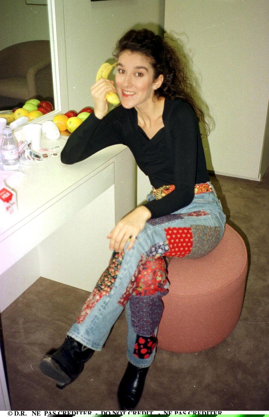 <p>Celine has channeled her creativity and whimsy into her outfits for decades, and here's proof: patchwork denim, plus a black top and black boots, because all of the attention should be on those jeans. </p>