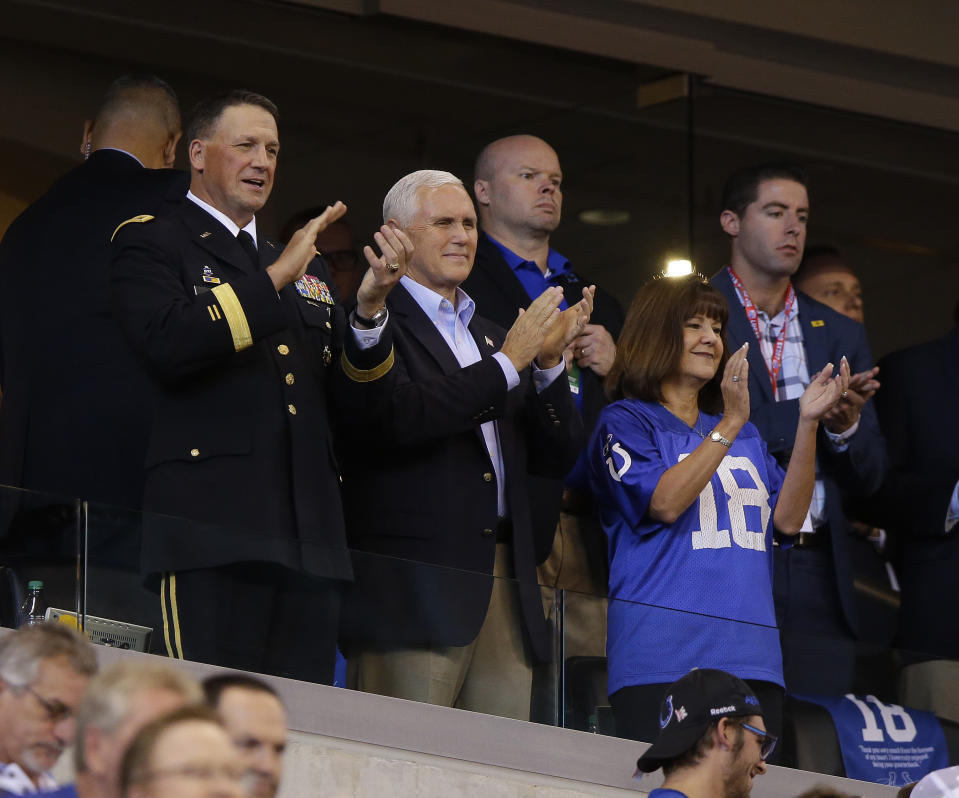 Vice President Mike Pence applauds before an NFL football game