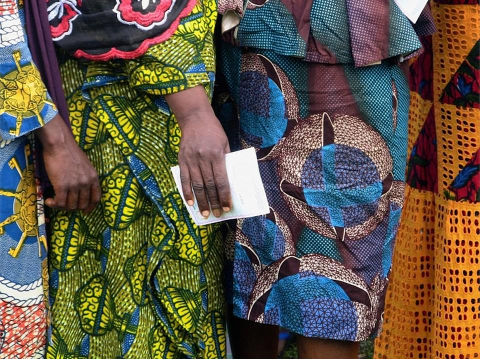 "Women wait to cast their ballots at a polling station during the Guinea""s presidential election in Fria, Guinea October 18, 2020."