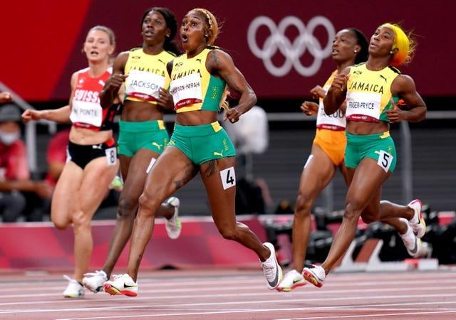 Jamaica enjoyed a clean sweep in the women's 100m final as Elaine Thompson-Herah, centre, took gold