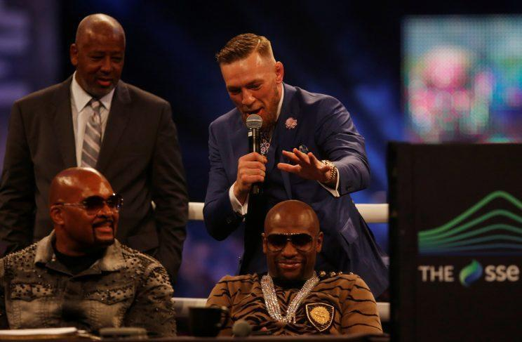 Conor McGregor goes to palm Floyd Mayweather's head in London against the advice of Dana White. (REUTERS)