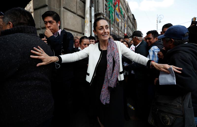 Claudia Sheinbaum, Mexico City's newly sworn in mayor, takes a walk to the Zocalo in Mexico City, on Wednesday, Dec. 5, 2018. Sheinbaum is Mexico City's first elected female mayor. (AP Photo/Eduardo Verdugo)