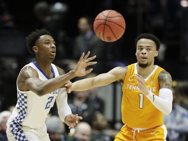Kentucky guard Ashton Hagans (2) passes past Tennessee guard Lamonte Turner (1) in the first half of an NCAA college basketball game at the Southeastern Conference tournament Saturday, March 16, 2019, in Nashville, Tenn. (AP Photo/Mark Humphrey)