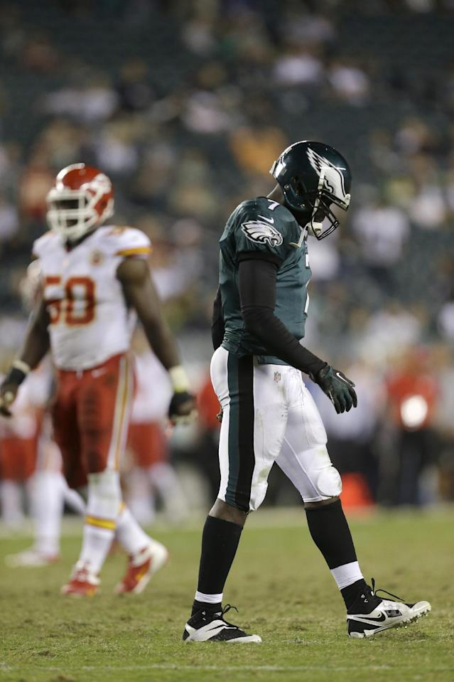 Philadelphia Eagles' Michael Vick, walks off the field after fumbling the ball in the final minutes of an NFL football game against the Kansas City Chiefs, Thursday, Sept. 19, 2013, in Philadelphia. Kansas City won 26-16. (AP Photo/Julio Cortez)