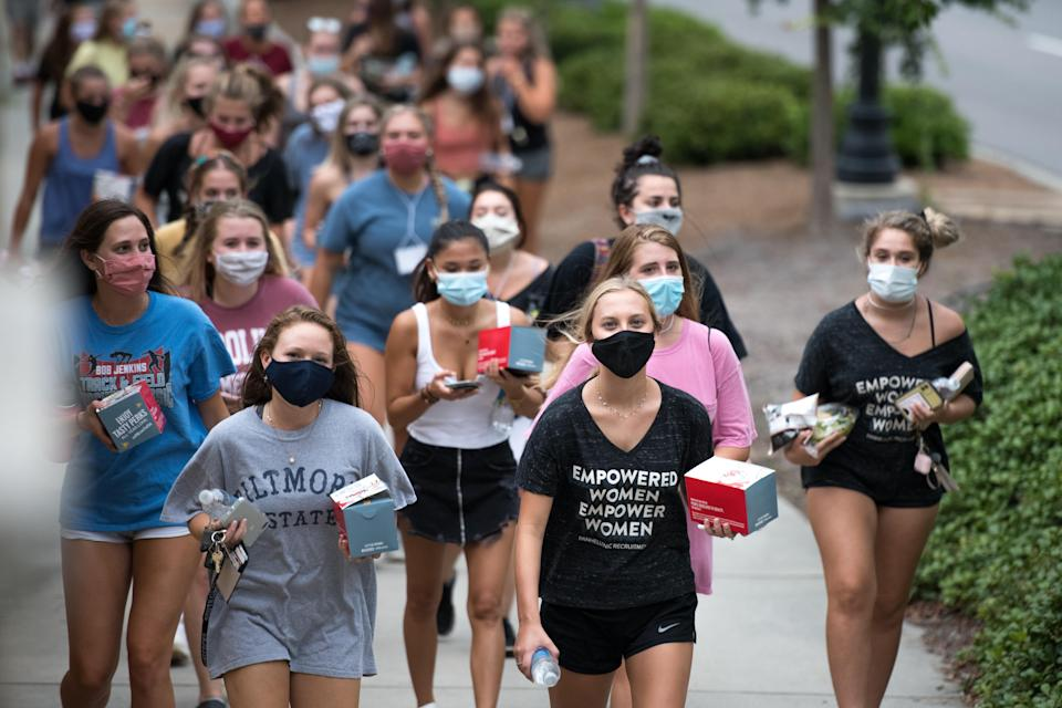 College students walk to dinner at the University of South Carolina on August 10, 2020 in Columbia, South Carolina. Students began moving back to campus housing August 9 with classes to start August 20. (Photo by Sean Rayford/Getty Images)
