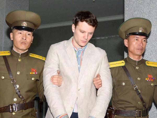 Otto Frederick Warmbier (C), a University of Virginia student who was detained in North Korea since early January, is taken to North Korea's top court in Pyongyang, North Korea, in this photo released by Kyodo March 16, 2016. REUTERS/Kyodo