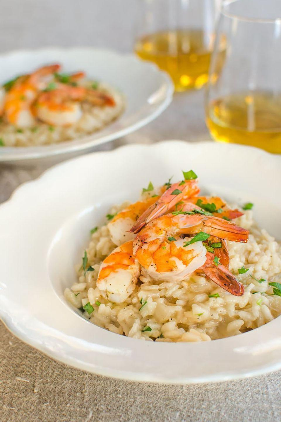 """<p>Enjoy a glass of wine and take turns stirring the risotto with your loved one for a meal that's simple but special.</p><p><strong>Get the recipe at <a href=""""http://www.thekitchn.com/recipe-parmesan-risotto-with-roasted-shrimp-recipes-from-the-kitchn-200084"""" rel=""""nofollow noopener"""" target=""""_blank"""" data-ylk=""""slk:The Kitchn"""" class=""""link rapid-noclick-resp"""">The Kitchn</a>.</strong></p>"""