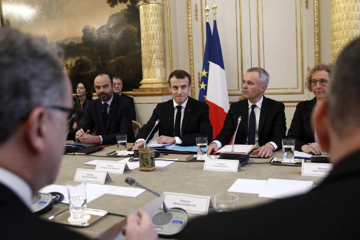 French President Emmanuel Macron, center, French Prime Minister Edouard Philipppe, left, and Environment Minister Francois de Rugy, second right, and Labor Minister Muriel Penicaud meet with representatives of trade unions, employers' organizations and local elected officials at the Elysee Palace in Paris, Monday, Dec.10 2018. Macron is preparing to speak to the nation Monday at last, after increasingly violent and radicalized protests against his leadership and a long silence that aggravated the anger. (Yoan Valat, Pool via AP)