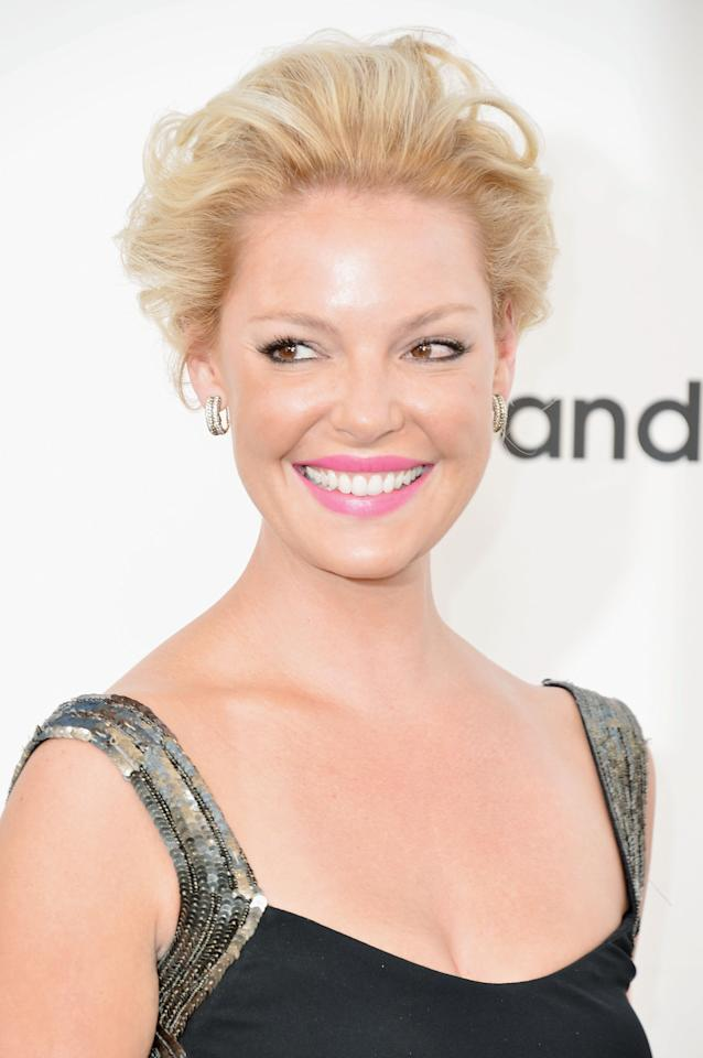 <b>Katherine Heigl </b>styled her hair into an undone updo, teasing curled hair to make it loose and feminine.