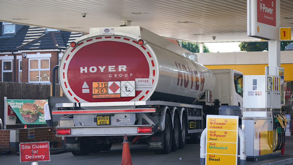 A delivery of fuel at a shell garage
