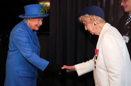 Britain's Queen Elizabeth shakes hands with Bletchley Park veteran Ruth Bourne during her visit at the Watergate House to mark the centenary of the GCHQ (Government Communications Head Quarters) in London, Britain, February 14, 2019. REUTERS/Hannah McKay/Pool