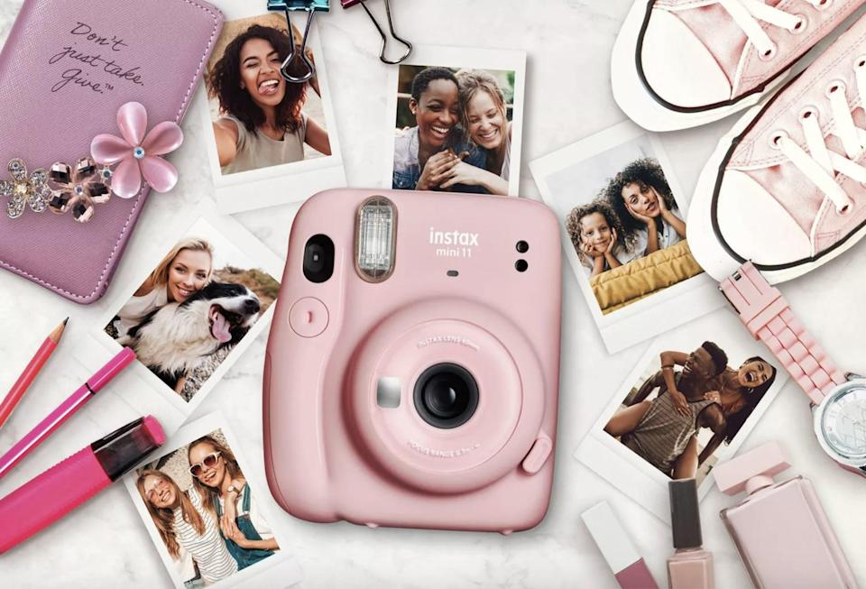 <p>If she loves to take pictures of friends and family or have a knack for photography, get her the <span>Fujifilm Instax Mini 11 Camera</span> ($70). You can instantly capture and print out pictures in real time for that retro aesthetic. It comes in a variety of colors as well.</p>
