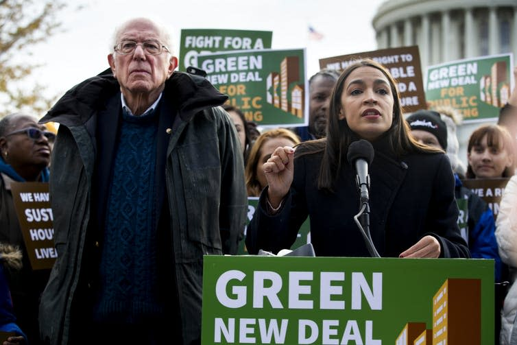 Bernie Sanders and AOC at a Green New Deal rally.