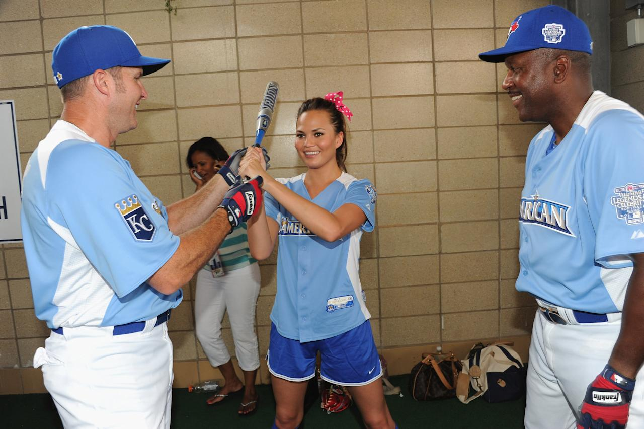 KANSAS CITY, MO - JULY 08:  Former MLB players Mike Sweeney (left) and Joe Carter (far right) and model Chrissy Teigen attend the 2012 Taco Bell All-Star Legends & Celebrity Softball Game at Kauffman Stadium on July 8, 2012 in Kansas City, Missouri.  (Photo by Rick Diamond/Getty Images)