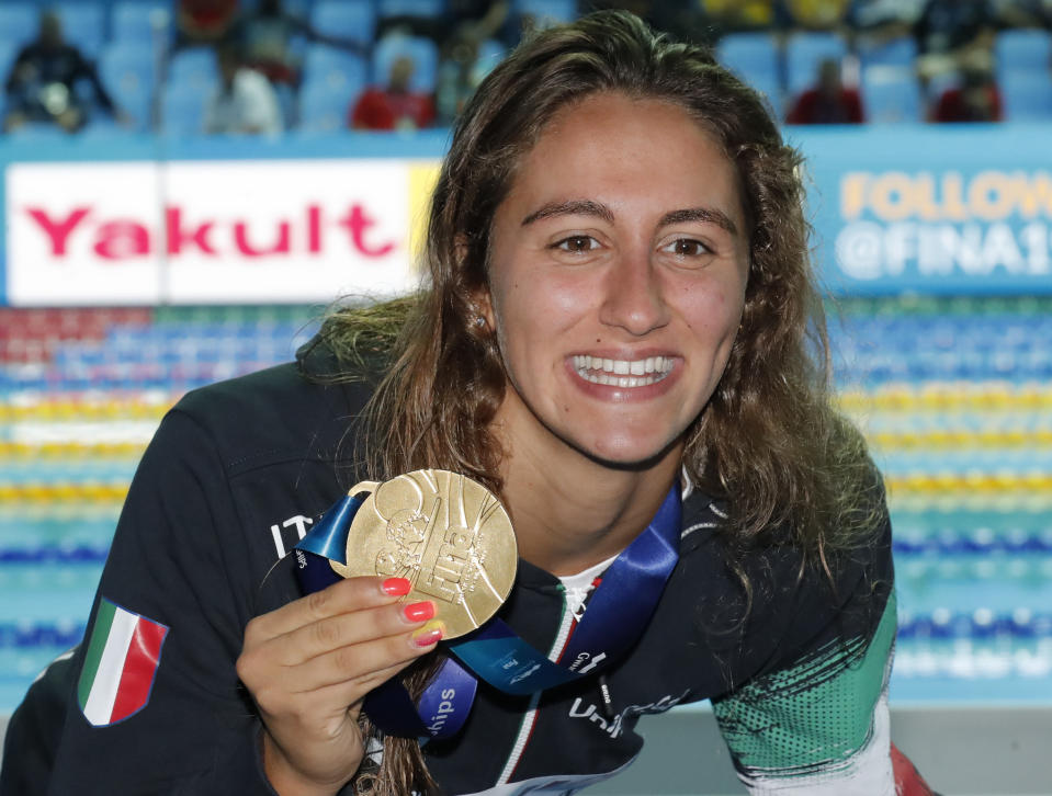 FILE - In this July 23, 2019 file photo, Italy's Simona Quadarella poses with her gold medal after winning the women's 1500m freestyle final at the World Swimming Championships in Gwangju, South Korea. Simona Quadarella is one of the few swimmers capable of challenging American standout Katie Ledecky in the longest pool races at the Tokyo Olympics. The Italian swam to gold in the 1,500-meter freestyle when Ledecky withdrew from the final due to illness at the 2019 world championships. She also stayed with Ledecky until the very last lap of the 800 in 2019 and came away with silver. (AP Photo/Lee Jin-man, file)