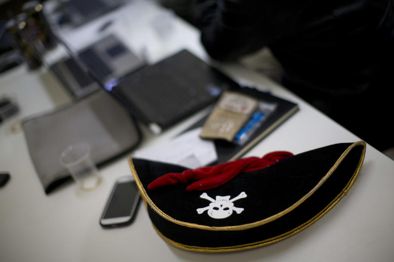In this Monday, Dec. 31, 2012, a pirate hat is seen on a table during a meeting of the Israel Pirate Party in Jerusalem. The Israel Pirate Party is one of 34 lists competing in the country's Jan. 22 national election. While only a dozen or so have a realistic chance of getting elected, many Israelis fed up with existential issues like the conflict with the Palestinians and possible war with Iran are seeking sanctuary in some of the quirkier parties running. (AP Photo/Bernat Armangue)