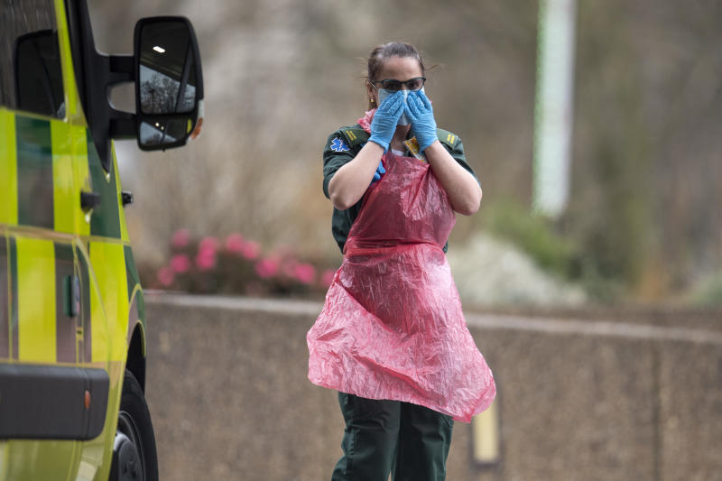 LONDON, UNITED KINGDOM - APRIL 01: A hospital worker adjust her face mask outside St Thomas' hospital on April 01, 2020 in London, England. The Coronavirus (COVID-19) pandemic has spread to many countries across the world, claiming over 40,000 lives and infecting hundreds of thousands more. (Photo by Justin Setterfield/Getty Images)