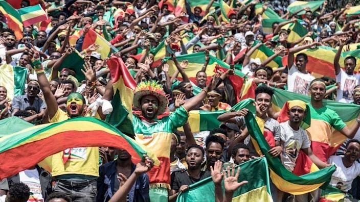 Ethiopians wave national flags and celebrate in the streets of Addis Ababa the return of Berhanu Nega, the leader of the former armed movement Ginbot 7, after 11 years in exile, on September 9, 2018