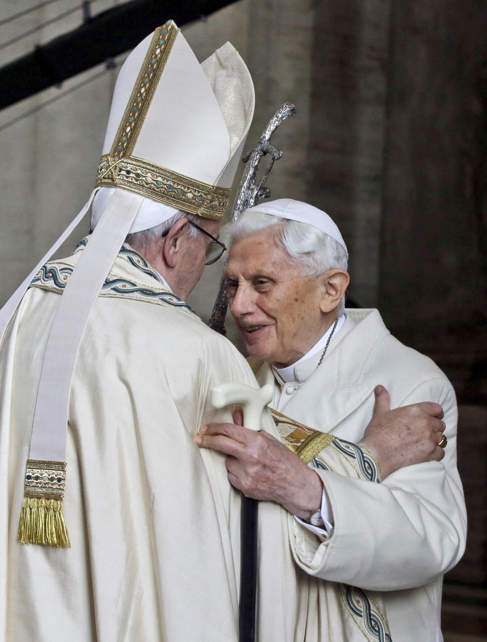 """FILE - In this Dec. 8, 2015 file photo, Emeritus Pope Benedict XVI, right, hugs Pope Francis inside St. Peter's Basilica during the ceremony marking the start of the Holy Year, at the Vatican. Emeritus Pope Benedict XVI has marked the eighth anniversary of his historic resignation by insisting in an interview published in Corriere della Sera Monday, March 1, 2021, that he stepped down knowingly and that """"there is only one pope"""" _ Francis. (AP Photo/Gregorio Borgia, file)"""