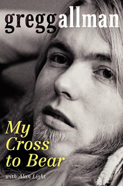 "In this book cover image released by William Morrow, ""My Cross to Bear,"" by Gregg Allman with Alan Light, is shown. Rock and Roll Hall of Fame member Gregg Allman is delaying his upcoming book tour for heart tests. Allman is scheduled to undergo tests Friday at The Mayo Clinic in Jacksonville, Fla., the same facility where he underwent a liver transplant in June 2010. (AP Photo/William Morrow)"