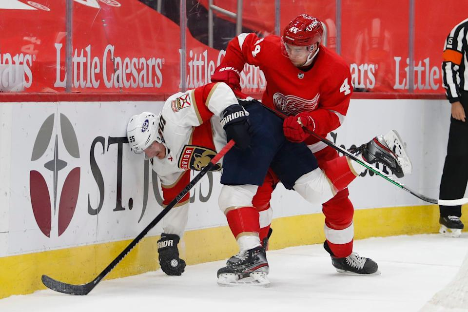 Florida Panthers center Noel Acciari (55) controls the puck against Detroit Red Wings defenseman Christian Djoos (44) during the first period at Little Caesars Arena on Sunday, Jan. 31, 2021.