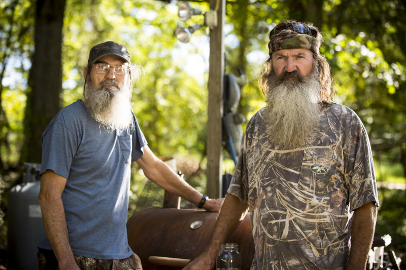 "This undated image released by A&E shows brothers Silas ""Uncle Si"" Robertson, left, and Phil Robertson from the popular series ""Duck Dynasty."" Phil Robertson was suspended last week for disparaging comments he made to GQ magazine about gay people. (AP Photo/A&E, Zach Dilgard)"