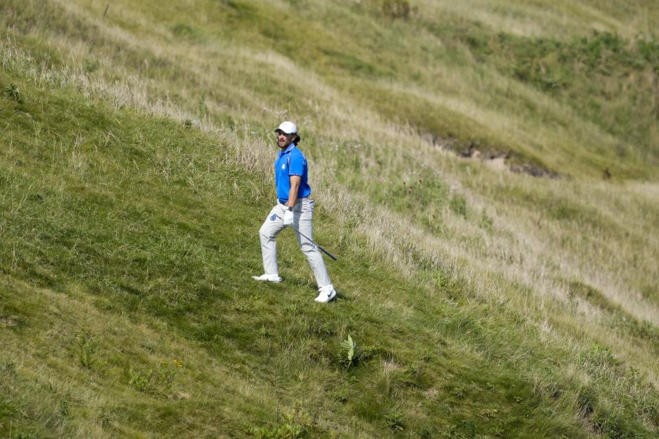 Team Europe's Tommy Fleetwood looks at his shot on the fourth hole during a four-ball match the Ryder Cup at the Whistling Straits Golf Course Friday, Sept. 24, 2021, in Sheboygan, Wis. (AP Photo/Charlie Neibergall)