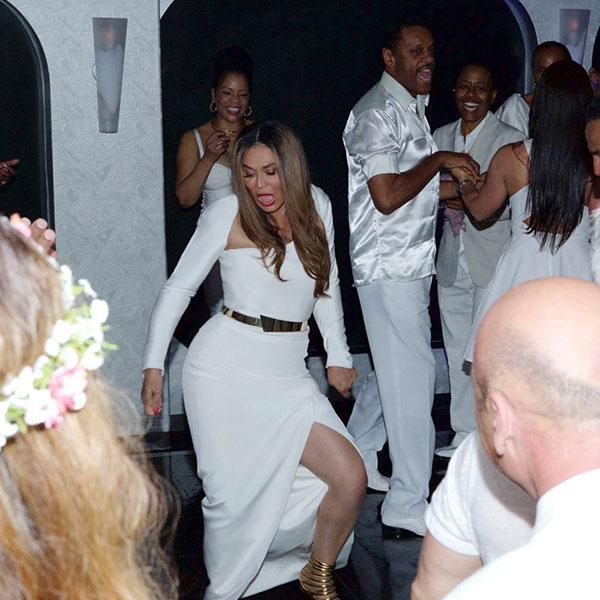 """It's safe to say Beyonce and Jay Z's adorable three-year-old daughter Blue Ivy had quite the good time at her grandmother Tina Knowles' wedding last week to actor Richard Lawson. Beyonce shared a few super-cute pictures of Blue Ivy celebrating the happy occasion on her website, in which her daughter sports a poofy white tulle dress, a tiara and wore her hair in adorable buns. Check her out all smiles with her dad Jay Z, her cousin Daniel Julez, her aunt Solange and her uncle Alan Ferguson. Beyonce PHOTOS: Blue Ivy's Most Adorable Moments Blue also hit the dance floor during the night, keeping close to Jay. Have you ever seen the """"Holy Grail"""" rapper look this happy?! Beyonce But perhaps the fiercest dance of the night belonged to Blue and Solange, who judging by this pic, had all of their fellow wedding guests in a spell. Beyonce Tina and Richard -- who've known each other for 33 years before their relationship turned romantic a year and a half ago, following her 2011 divorce from Matthew Knowles -- wed aboard a yacht in Newport Beach, Calif., on April 12. According to the bride herself, it was Blue Ivy who convinced them to tie the knot! """"[In September] we went on a boat with Beyoncé and Jay Z for her birthday, and when we came out one night dressed to go to dinner, Blue said, 'Oh, ya'll look beautiful. When are ya'll getting married?'"""" Tina recently told <em>People</em>. """"Richard said, 'Oh, Blue, soon. Do you approve?' And she said yes. That's the first time we talked seriously about getting married."""" Beyonce Beyonce VIDEO: Tina Knowles Spills Solange Wedding Details Check out the video below to see Beyonce, Solange and Kelly Rowland's amazing all-white outfits at Tina's wedding."""