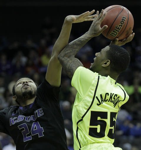 Baylor guard Pierre Jackson (55) puts up a shot under pressure from Kansas State guard Jeremy Jones (24) during the first half of an NCAA college basketball game in the Big 12 Conference tournament, Thursday, March 8, 2012, in Kansas City, Mo. (AP Photo/Charlie Riedel)
