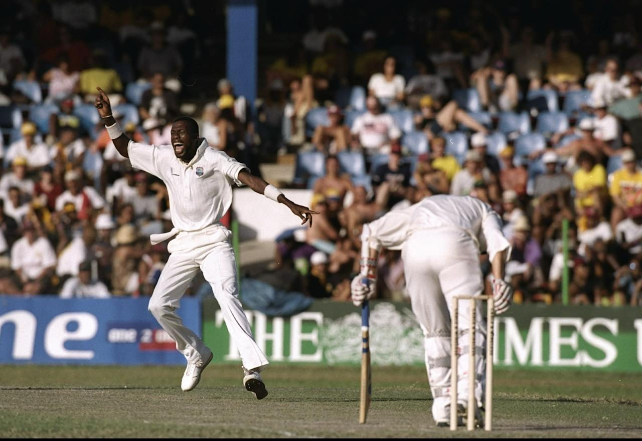13 Feb 1998:  Curtly Ambrose of the West Indies celebrates after he takes the wicket of England Captain Mike Atherton during the Third Test match at the Queen's Park Oval in Port-of-Spain, Trinidad. England won by three wickets to level the series.