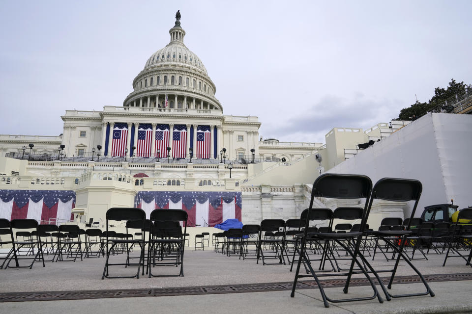 Chairs are positioned socially distanced from each other as preparations take place for President-elect Joe Biden's inauguration ceremony at the U.S. Capitol in Washington, Saturday, Jan. 16, 2021. (AP Photo/Patrick Semansky)