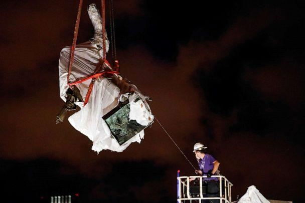 PHOTO: Crew members remove the Christopher Columbus statue from the Grant Park in Chicago, July 24, 2020. (Kamil Krzaczynski/Reuters)