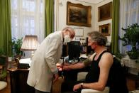 Kormendi, 97-year-old doctor, examines a patient in his doctor's office at his home in Budapest
