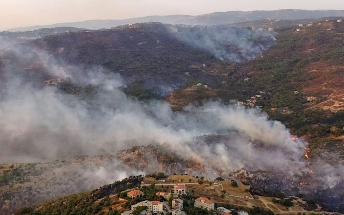 An aerial picture shows smoke billowing from a forest fire in Lebanon's Ras El Metn area - -/AFP