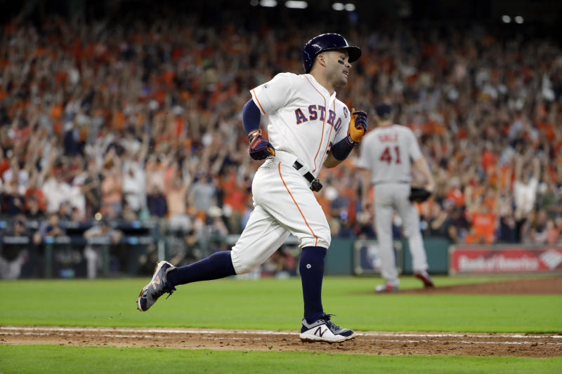 Houston Astros' Jose Altuve runs the bases after hitting a solo home run off Boston Red Sox starting pitcher Chris Sale (41) during the fifth inning in Game 1 of a baseball American League Division Series, Thursday, Oct. 5, 2017, in Houston. (AP Photo/David J. Phillip)