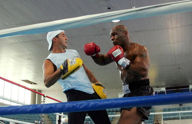 FILE - In this June 7, 2005, file photo, former Heavyweight Champion Mike Tyson, right, spars with his trainer Jeff Fenech in the ring at Burr Gymnasium in Washington. Fenech will undergo surgery in Bangkok to repair an infected heart valve. Australian boxer Jack Brubaker tells The Associated Press his mentor is hospitalized with a bad lung infection but remains conscious. (AP Photo/Pablo Martinez Monsivais, File)