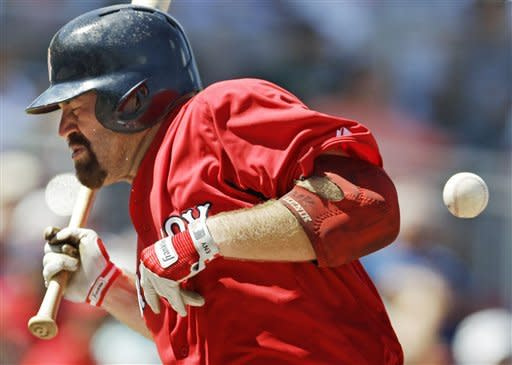 Boston Red Sox's Kevin Youkilis reacts as he is hit by a pitch thrown by Minnesota Twins Carl Pavano during the sixth inning of a spring training baseball game in Fort Myers, Fla., Sunday, April 1, 2012. (AP Photo/Charles Krupa)