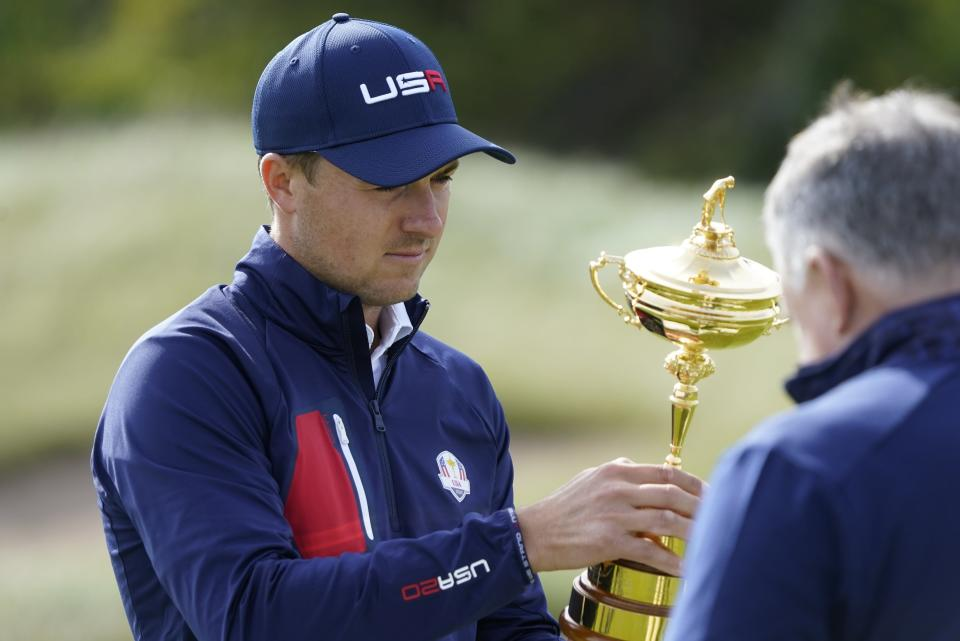 Team USA's Jordan Spieth looks at the Ryder Cup before a team photo during a practice day at the Ryder Cup at the Whistling Straits Golf Course Wednesday, Sept. 22, 2021, in Sheboygan, Wis. (AP Photo/Charlie Neibergall)