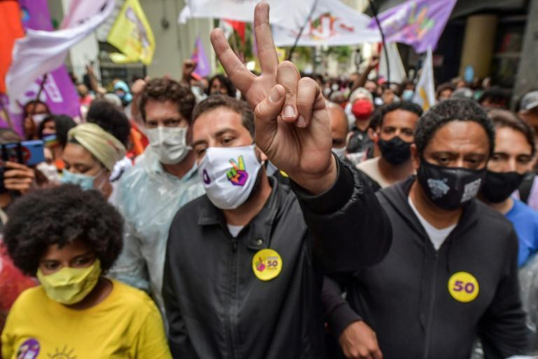 Guilherme Boulos, a 38-year-old leader of the Homeless Workers' Movement (MST), defied early opinion polls to survive for a runoff against the incumbent in Sao Paulo, center-right Mayor Bruno Covas