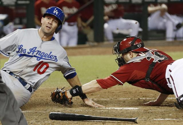 Los Angeles Dodgers' Michael Young (10) is called out on a play at home plate as Arizona Diamondbacks' Miguel Montero applies the tag in the sixth inning during a baseball game on Wednesday, Sept. 18, 2013, in Phoenix. (AP Photo/Ross D. Franklin)