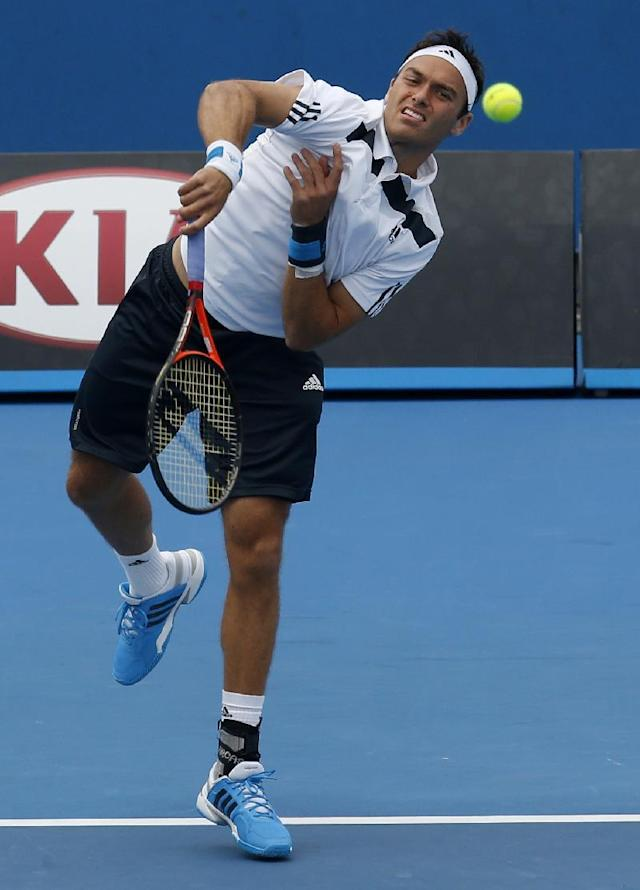 Britain's Ross Hutchins serves during his second round doubles match with compatriot Colin Fleming against India's Rohan Bopanna and Pakistan's Aisam-Ul-Hag Qureshi at the Australian Open tennis championship in Melbourne, Australia, Saturday, Jan. 18, 2014.(AP Photo/Eugene Hoshiko)