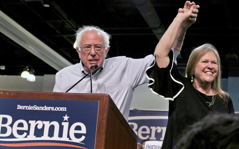 Democratic presidential candidate Sen. Bernie Sanders, I-Vt., with his wife, Jane O'Meara Sanders, salute the crowd as they arrive at a campaign event in Pasadena, Calif., in May. (Photo: Damian Dovarganes/AP)