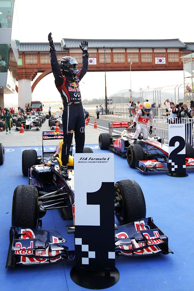 YEONGAM-GUN, SOUTH KOREA - OCTOBER 16: Sebastian Vettel of Germany and Red Bull Racing celebrates in parc ferme after winning the Korean Formula One Grand Prix at the Korea International Circuit on October 16, 2011 in Yeongam-gun, South Korea. (Photo by Clive Rose/Getty Images)